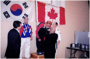 Receiving his Gold Medal at World Championships